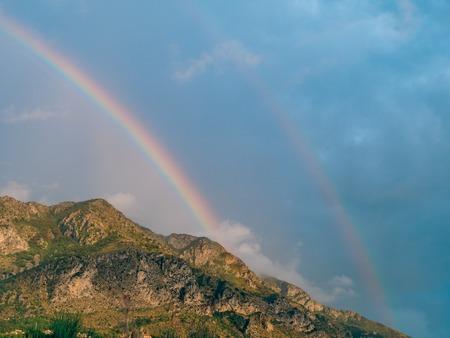 Double rainbow over the mountains. Montenegrin Mountains, the Balkans.