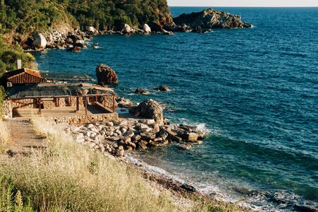 Cafe on a rocky sea shore in Montenegro. Deserted beach