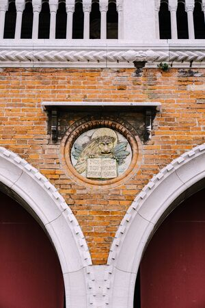 Close-ups of building facades in Venice, Italy. The lion of St. Mark is a symbol of the holy evangelist Mark, as well as the city of Venice, and one of elements of the flag of the Italian fleet. Stock fotó