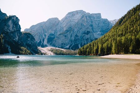 Rocky mountains with green forests at Lago di Braies. Braies lake in the Dolomites in South Tyrol, Italy, a municipality of Braies, in the Prague Valley.
