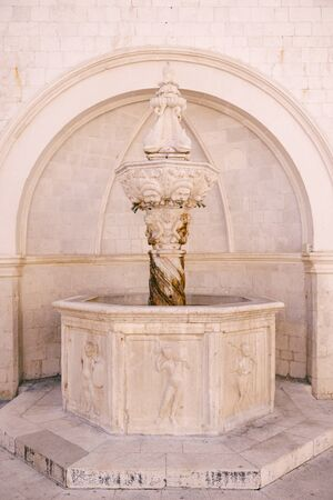 The small Onofrio fountain designed by the Italian architect Onofrio di Giordano della Cava at Stradun, the large street in the Old Town of Dubrovnik, Dalmatia, Croatia