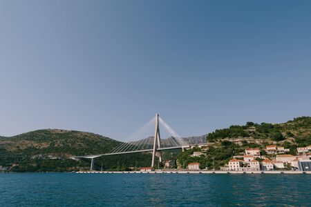Franjo Tudjman cable-stayed bridge carrying the D8 state road on the western approach to Dubrovnik, Croatia over the Dubrovacka river near the port of Gruzh. Imagens
