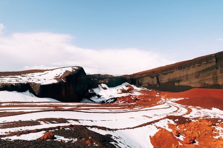 Martian landscapes in Iceland. The red crater of The Seydisholar volcano. The quarry of red soil mining. 写真素材