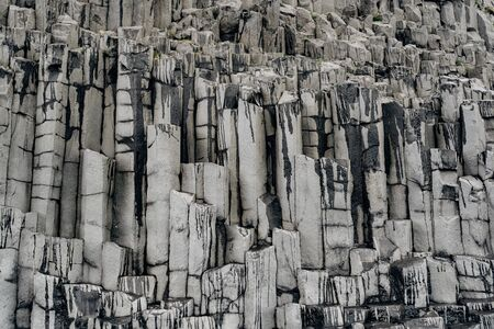 Closeup of texture of basalt stones on the beach of Vik, Iceland.