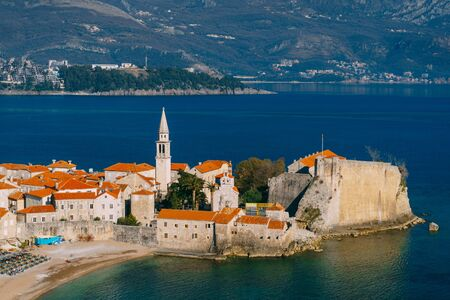 The old town of Budva, the blue sea and the mountains.