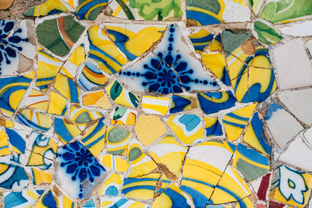 Close-up Mosaic Antonio Gaudi in the Park Guell, Barcelona