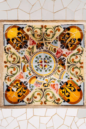 Close-up Mosaic Antonio Gaudi in the Park Guell, Barcelona. High quality photo