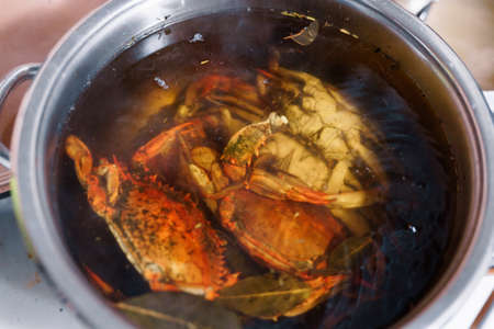 Red boiled blue crabs in boiling water with seasonings. High quality photo