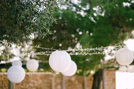 Paper lanterns. A garland of paper balls.