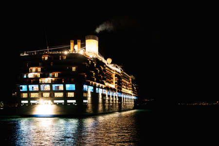 Close-up of a cruise liner in the sea at night. Night lighting of the ship.