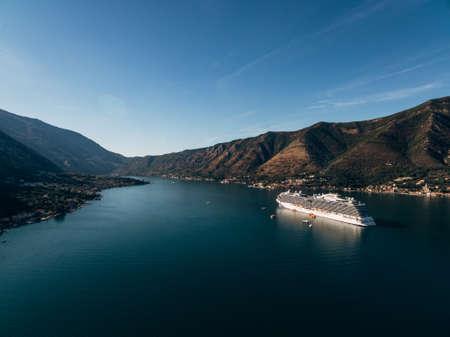 Cruise liner at dawn in Kotor Bay, near the old town of Kotor in Boka Kotorska, Montenegro. Stok Fotoğraf