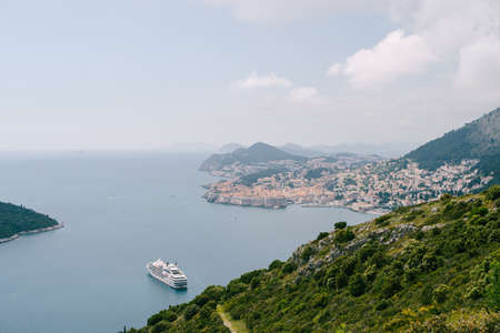 Cruise liner moored in the sea near the old city of Dubrovnik. Stok Fotoğraf