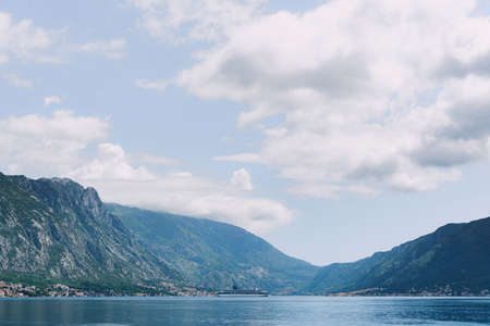 Cruise liner in the bay among the mountains in Montenegro. Stok Fotoğraf