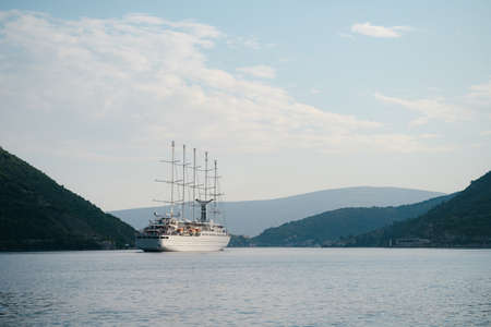A small sailing liner in the Bay of Kotor in Montenegro. Five sailing masts.