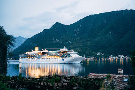 The cruise liner sails at night on the Bay of Kotor in Montenegro, near Perast. Stok Fotoğraf
