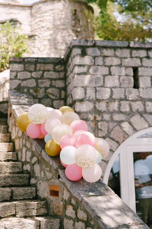 Bundles of helium balloons in pastel pink colors to decorate a wedding party. Stock Photo