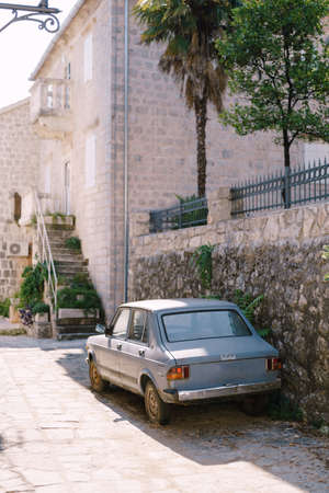 Zabljak, Montenegro - 23 july 2020: Abandoned blue car parked near a stone building. Zastava Skala, also known as Yugo Skala, or Zastava 101 Editorial