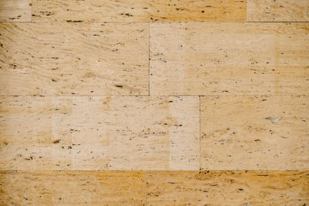Close-up texture of beige travertine, on wall tiles.
