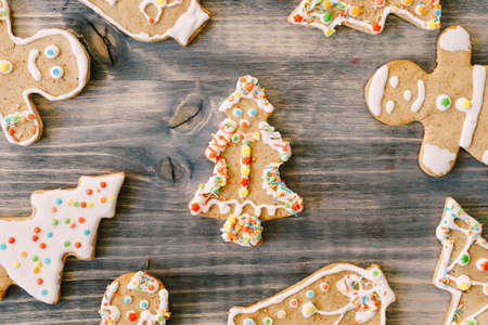 Christmas and New Year celebration traditions. Texture with homemade gingerbread cookies on wooden table. Family home bakery, cooking festive sweets 스톡 콘텐츠