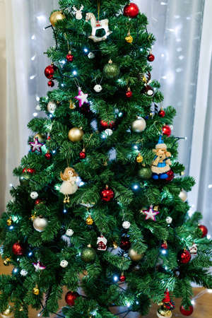 Close-up of a festively decorated Christmas tree with toys, balls and garlands. 스톡 콘텐츠