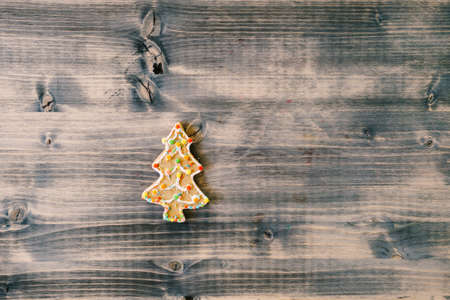 Christmas homemade gingerbread cookies decoration on baking sheet old wooden background. Xmas baking concept. Greetings card. Top view. Copy space.