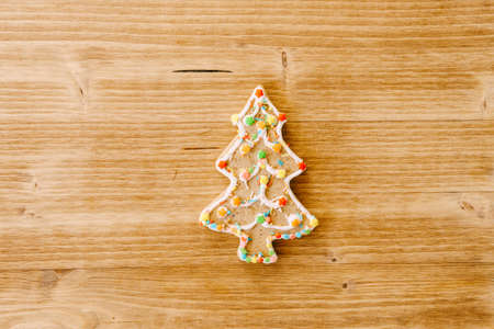 Festive food, kitchen background, texture with homemade gingerbread cookies on wooden table. Christmas and New Year celebration traditions.