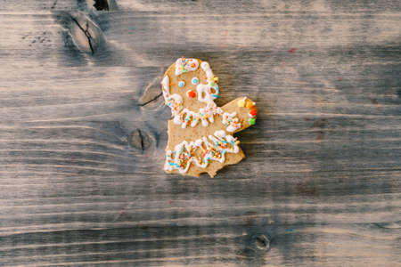 Partially eaten gingerbread man. Gingerbread in the shape of a man - without legs and arms. 스톡 콘텐츠