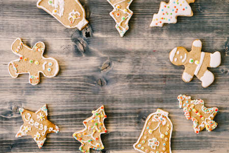 Frame of gingerbread cookies on a wooden background.