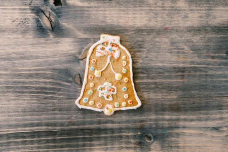 Christmas, New Year, DIY, holidays preparation and creativity concept. Getting ready to celebration. Festive decorations - homemade gingerbread cookies on wooden table. Imagens - 156872441