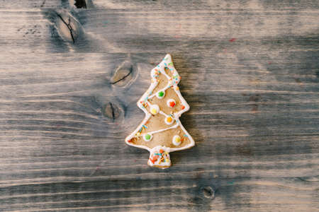 Festive food, kitchen background, texture with homemade gingerbread cookies on wooden table. Christmas and New Year celebration traditions
