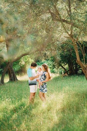 beautiful happy family in the olive grove in Montenegro Imagens
