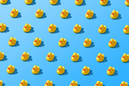 Flat lay of a creative summer yellow rubber duck pattern Imagens