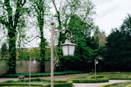 Close-up of a gray street lamp in the park on the alley. Imagens - 159185294