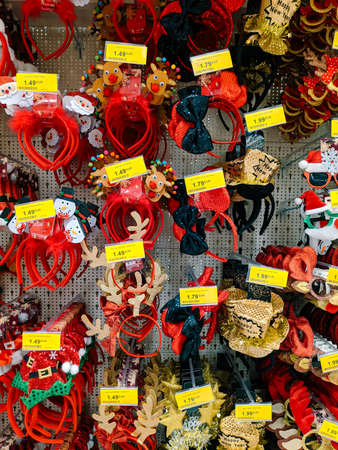 Budva, Montenegro - 15 December 2020: Christmas horns, bows and hats on the shelves in the mall.