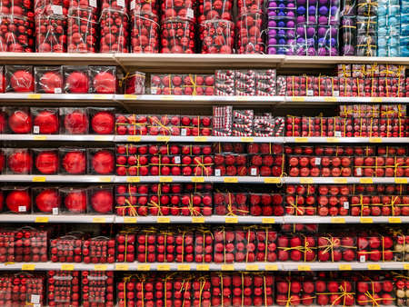 Budva, Montenegro - 15 December 2020: Red Christmas balls on the shelves in the supermarket.