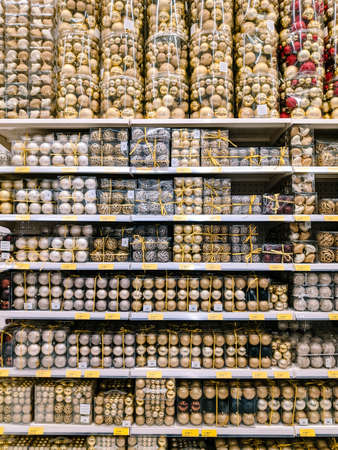 Budva, Montenegro - 15 December 2020: Gold and silver Christmas tree balls on the shelves in the supermarket. Editorial