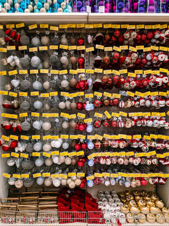 Budva, Montenegro - 15 December 2020: Christmas balls on the shelves in the supermarket. Editorial