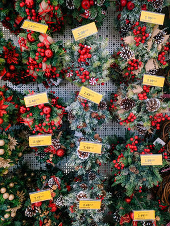 Budva, Montenegro - 15 December 2020: Decorated Christmas wreaths on the shelves in the supermarket.