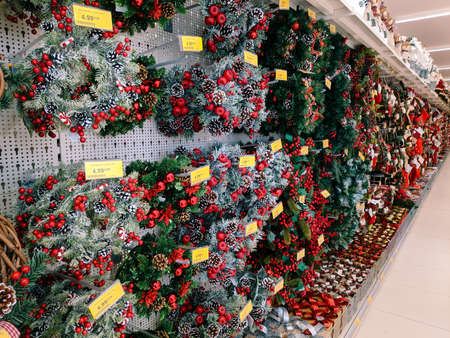 Budva, Montenegro - 15 December 2020: Supermarket shelves with Christmas and New Year decorations.
