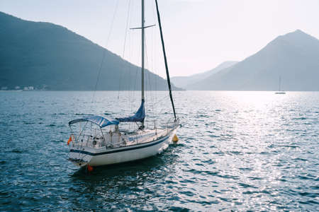 White sailing yacht moored in a bay in Montenegro. Imagens
