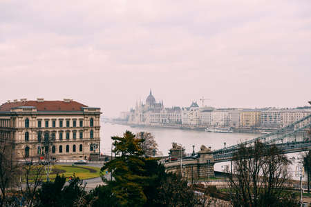 Great view of the parliament building, shrouded in haze, in daylight in Budapest Imagens