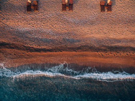 Aerial view of the beach with sun loungers in Montenegro