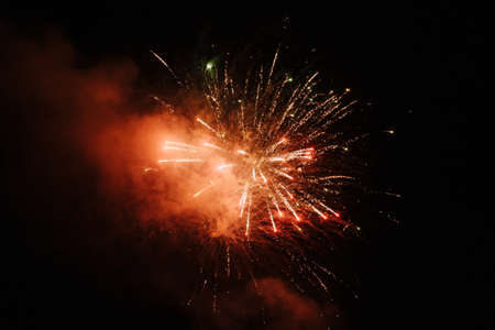 Bright fireworks explode in the night sky Imagens