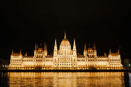Parliament building in beautiful night illumination in Budapest. Front view Imagens