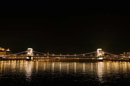 Night panorama of the Szechenyi chain bridge in Budapest with illumination