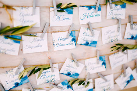 Seating plan. White board with a list of invited guests to the wedding. Close up