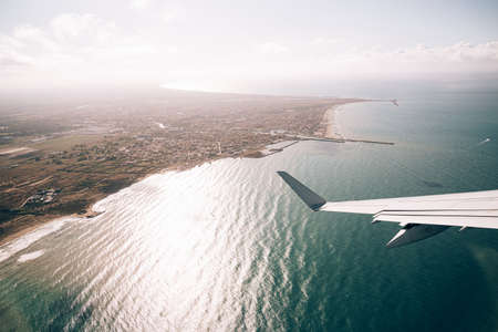 View from the planes window of the east coast of Italy and the sea below
