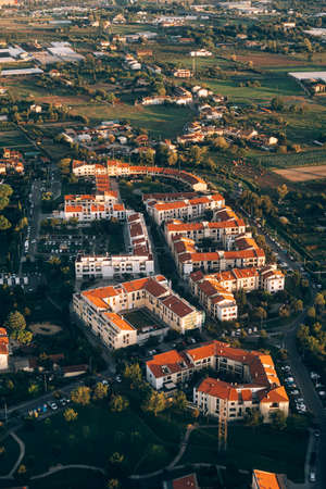 View from the airplane window to a beautiful residential complex surrounded by green spaces