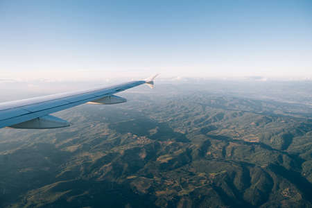 View from the plane window of the green mountain ranges of Tuscany