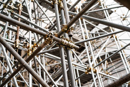 Close-up of scaffolding on the background of the building. Bottom view